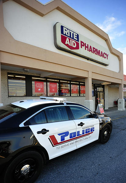A Hagerstown Police Department car sits Monday in front of the Rite Aid Pharmacy on North Burhans Boulevard. A man entered the store Monday afternoon, demanded Xanax and then fled with an undisclosed amount of the prescription drug.