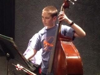 Jacob Pater on bass rehearses with the Crooked Tree Youth Orchestra.