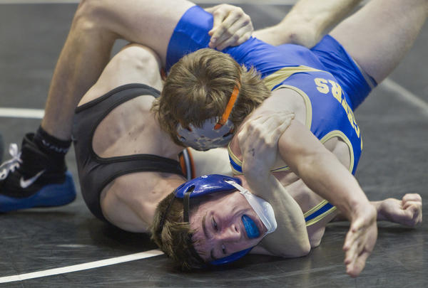 Smithfield's Ben Jones fights for position against Logan Meister of McDonogh High School during a 132-pound match at the Virginia Duals on Friday, January 11.