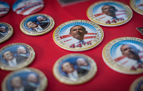 President Barack Obama buttons laid out for sale at the celebration at District 21's family-focused inauguration celebration held at Behnke Nurseries in Beltsville.