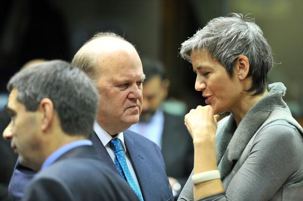 Irish Finance Minister Michael Noonan, center, and Danish Economy Minister Margrethe Vestager talk Tuesday before a meeting at European Union headquarters in Brussels.