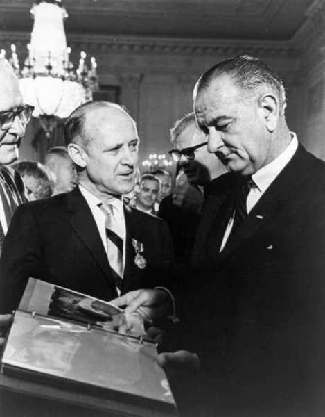 JPL Director William Pickering presents the first close-up images of Mars to President Lyndon Johnson in July 1965.