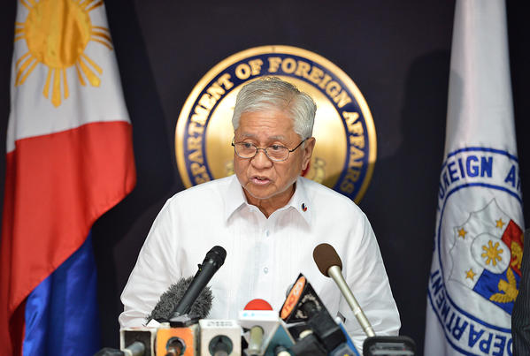 Philippines Foreign Affairs Secretary Albert del Rosario reads a statement during a press conference in Manila on Tuesday.