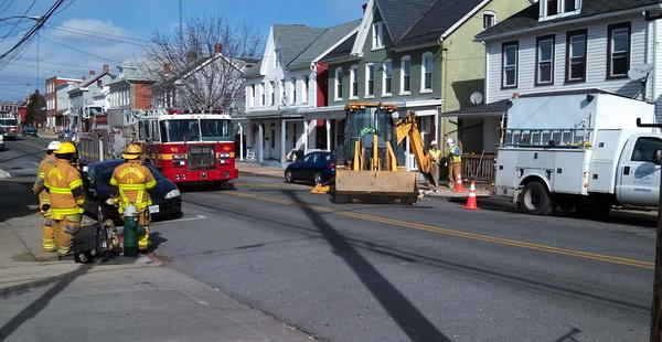 Firefighters and a crew from Columbia Gas are seen at the site of a gas leak in the 200 block of Frederick street on Tuesday.