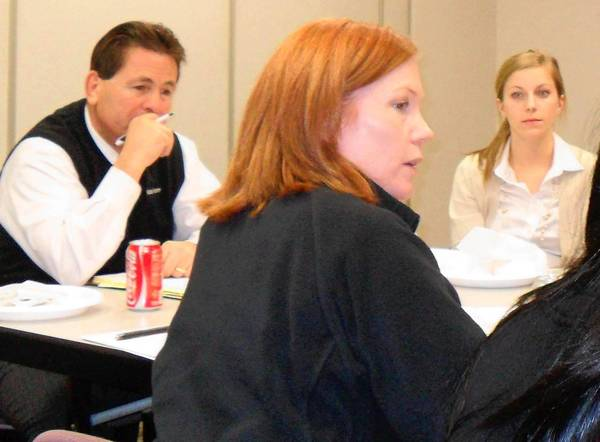 Main Street Commission members Jim Fuentes and Marissa Caruso listen as Creative Cakes co-owner Beth Fahey discusses her company's 7,000-contact database during a wide-ranging discussion about gaining and keeping customers. It was the first meeting for Fahey, Caruso and veterinarian Amanda Young, who were appointed in late 2012.