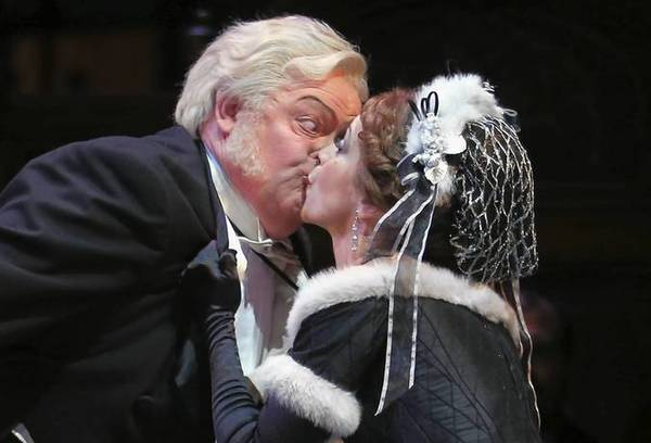 "Lucas Meachem, right, gets jealous watching Elizabeth Futral as Musetta kiss her ""protector"" Dale Travis as Alcindoro during the dress rehearsal of ""La Boheme"" at the Lyric Opera of Chicago."