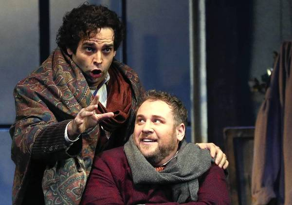 "Dimitri Pittas as Rodolfo, top, and Lucas Meachem as Marcello during the dress rehearsal of ""La Boheme"" at the Lyric Opera of Chicago."