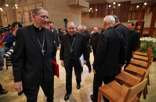 Documents reveal that Cardinal Roger M. Mahony, left, seen here in 2010 with his successor as archbishop of Los Angeles Jose Gomez, sought to conceal priest sex abuse from authorities.