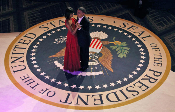 Jan. 20 - Private swearing in Jan. 21 - Public inauguration First Lady Michelle Obama dances with President Barack Obama at the Commander in Chief's ball in Washington.