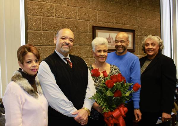 Longtime Will County Court bailiff Beverly Richardson, center, was surrounded by family at a retirement reception for her at the courthouse. From left are daughter, Mardissa Brown, a nurse; son, retired Will County Judge Marzell Richardson; Beverly Richardson; son, Joseph Richardson, a court liaison for the River Valley Justice Center; and niece, Karla Martin McCullum.