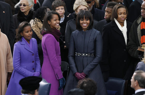 Sasha (left),Malia (center) and Michelle Obama at Monday's inauguration ceremonies.