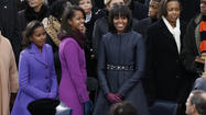 No critic could find fault with how first lady Michelle Obama looked in her ruby-colored Jason Wu gown and freshly cropped bangs at the inauguration balls. She radiated warmth and sophistication, and the red velvet and chiffon halter-top design complemented her figure (including those toned arms) even more than the white one-shoulder Jason Wu gown of four years ago.