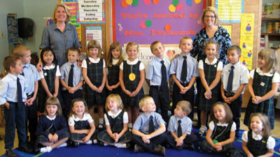 St. Peter School's kindergarten class poses for a group picture. Students are shown with kindergarten teacher Tammi Dirienzo and kindergarten aide, Polly Close. This was the first year for kindergarten at St. Peter School. Kindergarten and new student registrations will be accepted beginning Monday at the school.