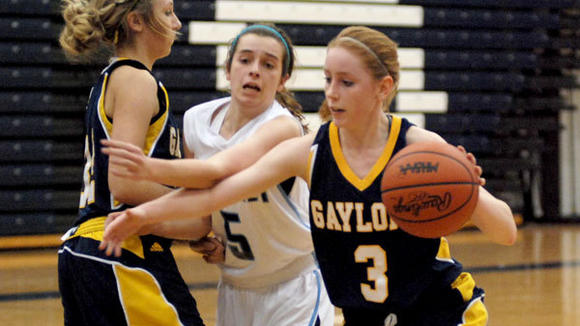 Gaylord senior guard Mackenzie Edwards uses a screen on Petoskey senior Liz Fraser as set by Stephanie Buttrick.