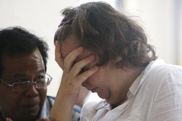 Lindsay Sandiford, right, listens to an interpreter during her sentencing at a district court in Bali, Indonesia, on Tuesday.