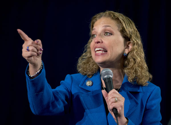 Rep. Debbie Wasserman Schultz (D-Fla.) was reelected as national party chairwoman in a hectic DNC election.