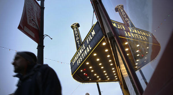 People pass the Egyptian Theatre on Main Street in Park City, Utah.