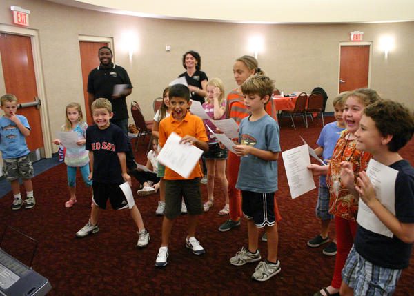 Children of Orlando Shakespeare Theater patrons participate in a PlayShop program.