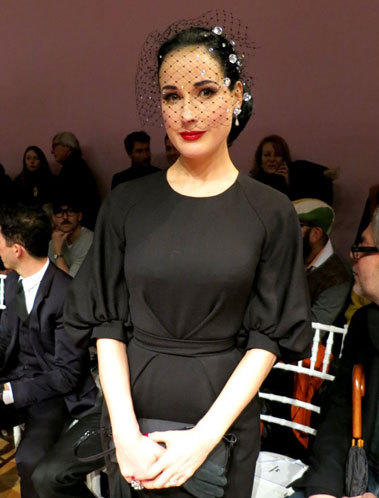 Dita Von Teese attends the Alexis Mabille Spring Summer 2013 Haute Couture runway presentation in Paris.