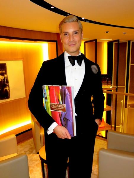 "Cameron Silver promotes his book ""Decades: A Century of Fashion"" in France."