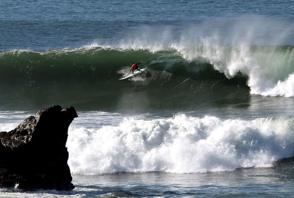 Alex Martins competes in heat four during the Mavericks Invitational surf competition on January 20, 2013 in Half Moon Bay, California.