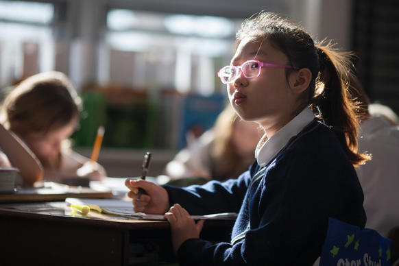 Lee Jeong Yoon, of South Korea, listens to the teacher during class at Resurrection-St. Paul School.