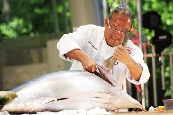 Chef Masaharu Morimoto demonstrates whole fish breakdown at Extra Mooga during The Great GoogaMooga - Day 2 at Prospect Park on May 20, 2012 in New York City.