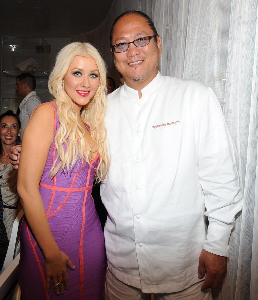 Singer Christina Aguilera (L) Iron Chef Masaharu Morimoto attends the Morimoto VIP dinner during the opening weekend of The Waikiki EDITION on October 16, 2010 in Honolulu, Hawaii.