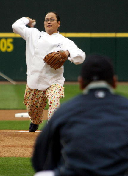 Celebrity cook Masaharu Morimoto (L), known on American TV as 'The Iron Chef', throws out the first pitch to Seattle Mariner Kazuhiro Sasaki (R) prior to the game betwenn Seattle and New York in Seattle, 07 May 2003.