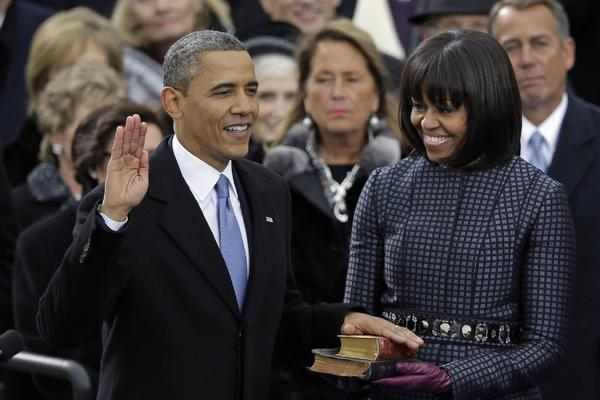 President Barack Obama receives the oath of office from Chief Justice John Roberts as first lady Michelle Obama watches during the ceremonial swearing-in at the U.S. Capitol during the 57th Presidential Inauguration in Washington, Monday, Jan. 21, 2013.