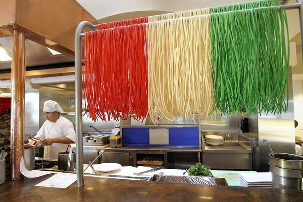 Fresh pasta hangs drying in the colors of the Italian flag at Prego Ristorante in Irvine.