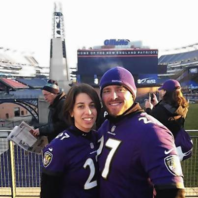 Laura Finney and her husband, Che, were lucky winners of the Ravens Golden Logo contest. They won 14th row tickets to Sunday's game in Foxboro, Mass, where they stand inside Gillette Stadium Sunday.