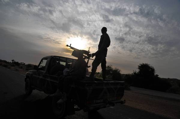 A Malian army vehicle patrols near Markala on Tuesday. The soldiers, with help from the French military, are battling Islamic militants in the North African country.