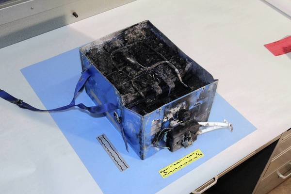 Problems linked to the 787 Dreamliner's lithium-ion batteries include this burned auxiliary power unit from a Japan Airlines plane.
