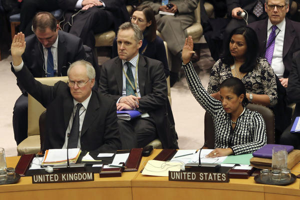 British Ambassador to the United Nations Mark Lyall Grant and U.S. Ambassador Susan Rice vote Tuesday on a Security Council resolution condemning North Korea's rocket launch.