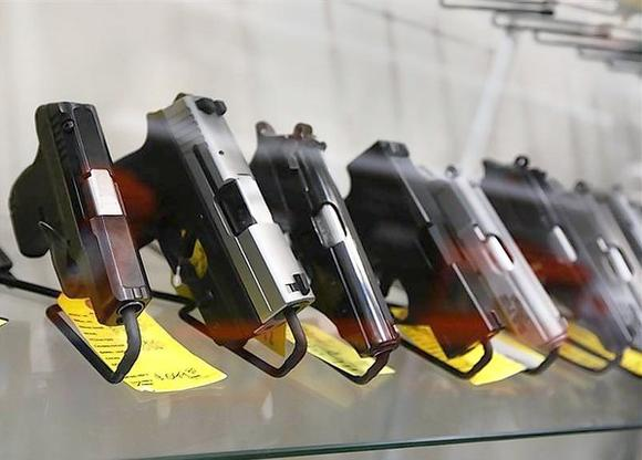 A display of 7-round handguns are seen at Coliseum Gun Traders Ltd. in Uniondale, New York