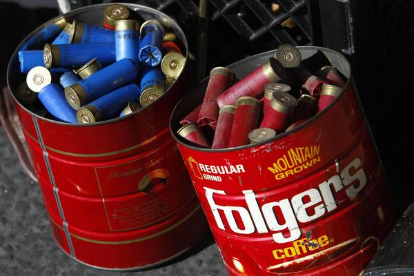 Shotgun shells are dropped off at a gun buyback. Years ago, a boy's discovery of a similar cache almost proved deadly.