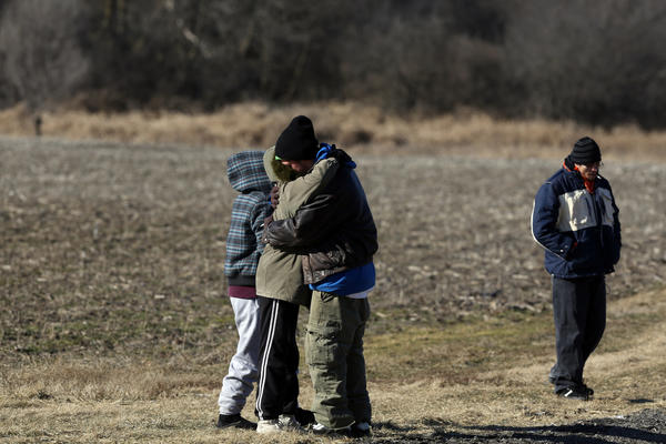 Searchers and friends of Joey Frase mourn his death following the recovery of his body in a field just west of Campbell Airport in Grayslake, Ill.