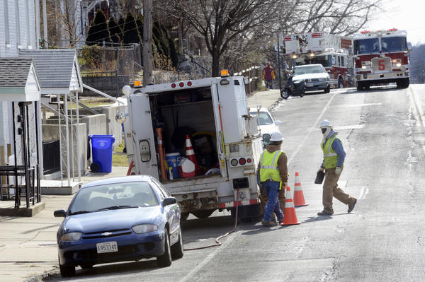 Columbia Gas personell work Tuesday at scene at of a natural gas leak at 252-254 Frederick St. in Hagerstown.