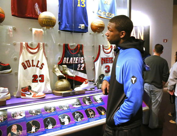 Simeon's Kendrick Nunn checks out some jerseys, at the Basketball Hall of Fame, in Springfield, Mass., on Sunday .