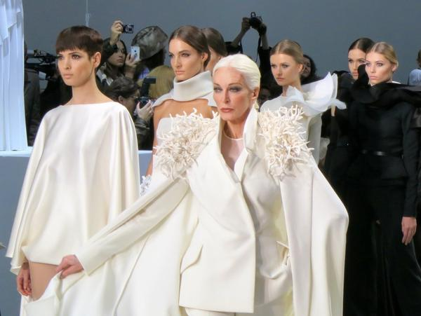 Carmen Dell'Orefice poses front and center in a caped bridal tuxedo on Tuesday at Stephane Rolland's haute couture show.