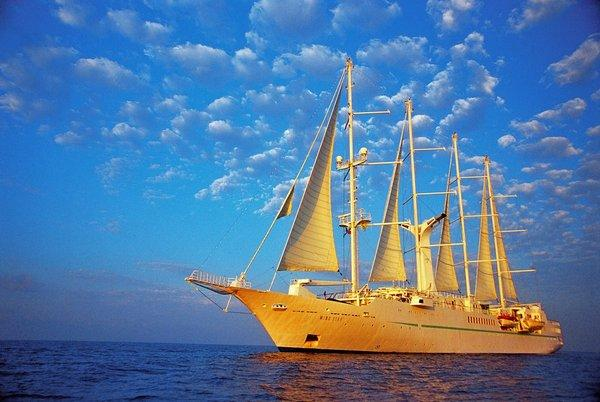 The Wind Star, a four-masted sailing yacht, can accommodate 148 passengers. The ship has four decks, a spa, entertainment lounge, library, pool and hot tub.