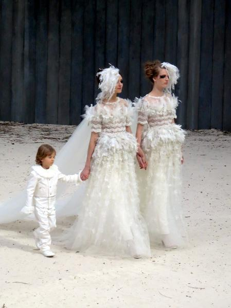 Chanel sent two brides and their son down the runway.