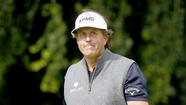 LA JOLLA — Phil Mickelson, an expert at applying backspin on the golf course, issued a statement clarifying comments he made Sunday indicating he might move out of California because of the state's income tax laws.