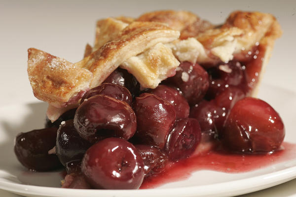 "Try this pie using fresh sweet cherries when they're in season. Lightly sweeten with sugar, and tossed the pitted fruit with a little Grand Marnier and vanilla to brighten the flavors and to give the cherries more depth. The resulting pie is simple but rich with flavor, with slightly firmer texture from the fresh fruit. <a href=""http://www.latimes.com/features/food/la-fo-fruitpierece-20100722,0,2708907.story"">Click here for the recipe.</a>"