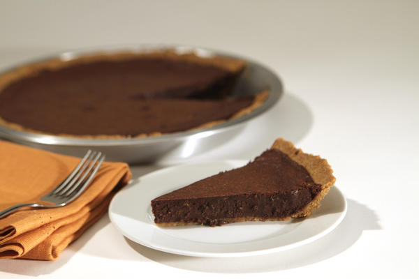 "With a graham cracker crumb crust and dense, fudgy filling, this brownie pie is a cross between molten chocolate cake and gooey brownies. <a href=""http://www.latimes.com/features/food/la-fo-momofuku-milk-20111208,0,1625838.story"">Click here for the recipe.</a>"