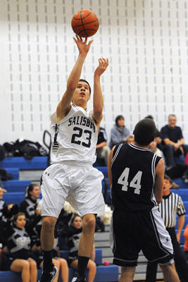 Salisbury's Austin Uhl (left) drives to the basket in front of Northern Lehigh's Caleb Johnson (right) during their Colonial League boys basketball game Tuesday night.