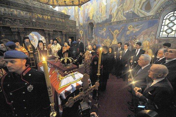 Serbian Patriarch Irinej performs a liturgy during a burial ceremony for the remains of Yugoslavia's last king, Peter II Karadjordjevic, in Belgrade, on Tuesday. The remains of the king, who fled the country at the onset of the Nazi invasion, were repatriated today for re-burial in Serbia, 43 years after his death in exile in the United States. After being exhumed last week from the Saint Sava monastary at Libertyville, the coffi, covered with the Serbian flag, was brought to the church at the royal palace of Karadjordjevic's in Belgrade.