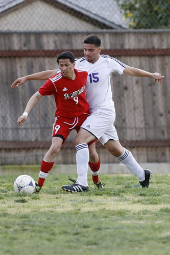 Burroughs' Nolberto Alcantar, left, and Hoover's Shadi Abdeldi fight for the ball during a game at Toll Middle School in Glendale on Tuesday, January 22, 2013.