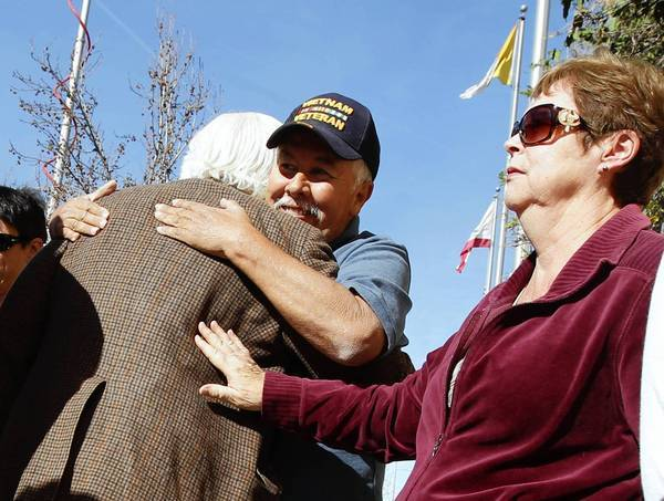 Frank Zamora and Sherida Ruiz comfort a victim during a news conference outside the Cathedral of Our Lady of the Angels in downtown Los Angeles in the wake of the release of reams of church sex abuse files.